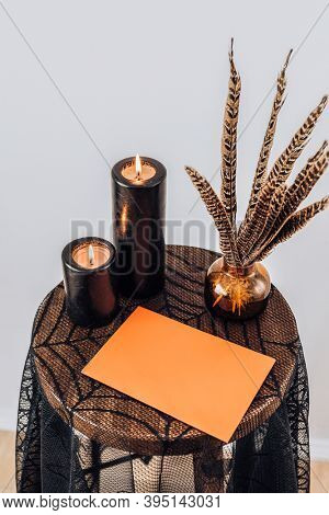 Orange Halloween card on a spider web lace tablecloth