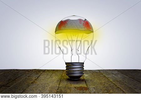 Light Bulb On Wooden Floor With Gauze Wrapping Demonstrating The Bad Ideas. Not Working This Idea. 3