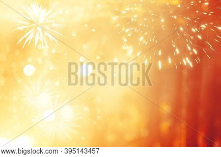 Magic golden holiday abstract background of sparkling fireworks. Christmas and New Year concept.