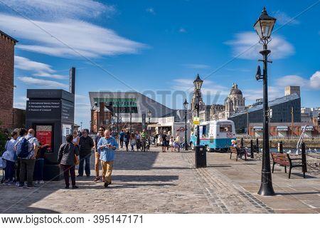 LIVERPOOL,UK - AUGUST 6,2019 : Summer scene at the historic Albert Dock in Liverpool