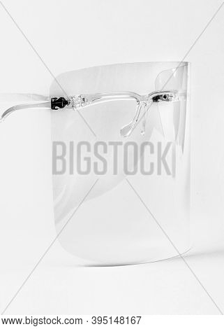 Eyewear with detachable face shield on a white background