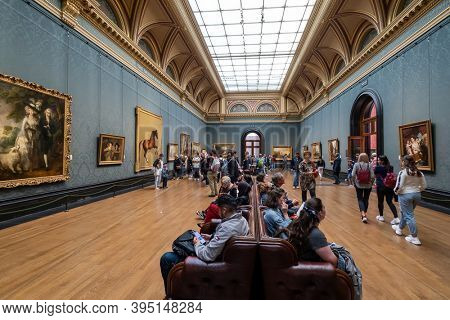 LONDON,UK - AUGUST 19,2019 : Visitors at the National Gallery in London. Founded in 1824 , it houses a collection of over 2300 paintings