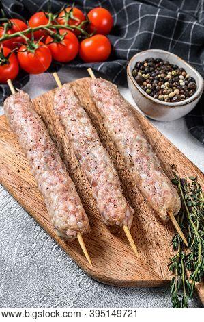 Fresh Raw Minced Pork Meat Skewers Kebabs. White Background. Top View