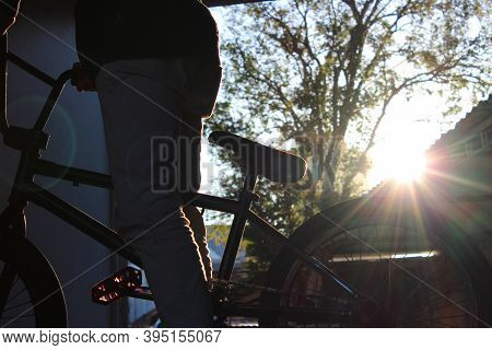 Blurred Silhouette Of A Biker Against The Sunset