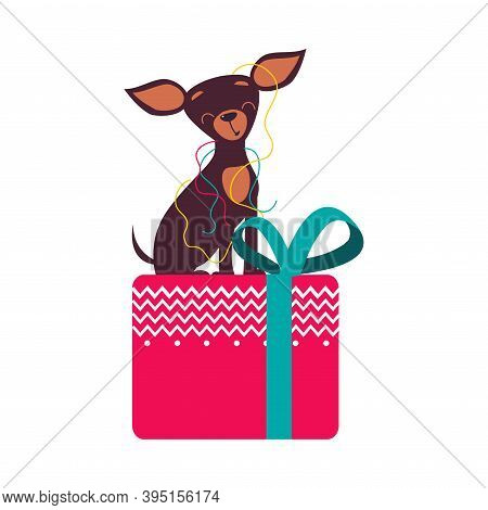 Funny Toy Terrier Dog Sitting On Presnt Box With Bow, Symbol Of Xmas And New Year, Happy Winter Holi