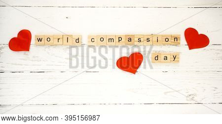 World Compassion Day.words From Wooden Cubes With Letters Photo