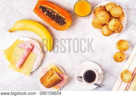 Traditional Brazilian Breakfast - Cheese Bread, Coffee, Ripe Fruit, Top View.