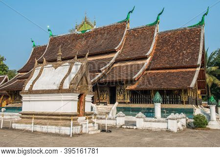 Side View Of Wat Xieng Thong An Iconic Temple In Luang Prabang, The Unesco World Heritage Town In No