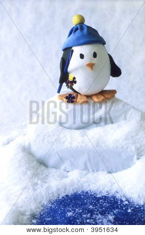 Small Toy Penguin Fishing