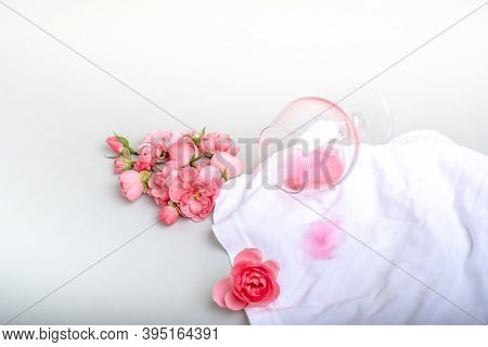 Inverted Glass And Poured Fine Rose Wine On A White Cloth. Place For Text