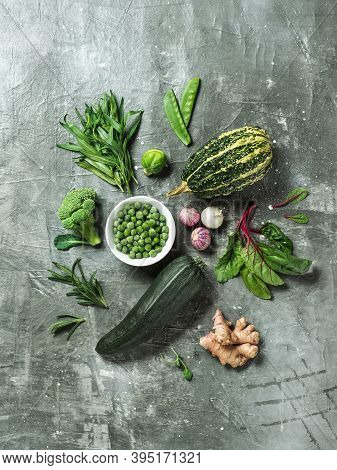 Green Vegetables And Herbs On Gray Background, Top View.still Life With Green Peas, Zucchini, Bean-p