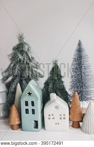 Christmas Scene, Miniature Holiday Village. Christmas Little Houses And Trees On White Background