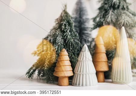 Christmas Scene, Miniature Winter Forest In Lights. Christmas Little Ceramic, Wooden And Snowy Pine