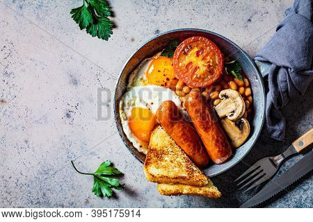 English Breakfast With Sausages, Beans, Fried Eggs, Toast, Mushrooms And Tomato In A Frying Pan, Dar