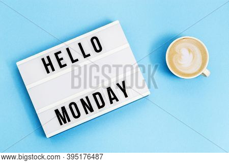 Text Hello Monday On Lightbox And Cup Of Coffee For Holiday - Thank God Its Monday. Start Of Working
