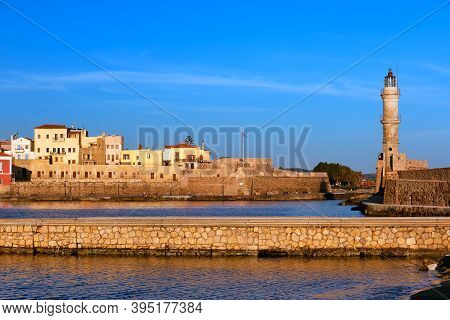 Beautiful Morning View Of Venetian Lighthouse, Firka Castle Walls And Piers Of Old Venetian Harbour
