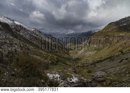 Snowy Mountains Landscape In The Aragonese Pyrenees. Cloudy View Of The Guarrinza Pastures, Near Of