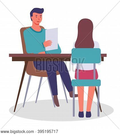 Interview In Office. Young Friendly Man Sits At Table With Document Or Resume Interviews Young Girl,