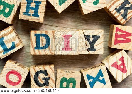 Alphabet Letter Block In Word Diy (abbreviation Of Do It Yourself) With Another On Wood Background