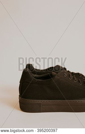 Woman's black canvas sneaker on gray