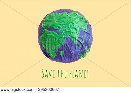 Ecology Concept, Environment, Plastic Free, Saving The Planet. Model Of Planet Wrapped In A Plastic