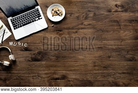Aerial view of computer laptop on wooden table