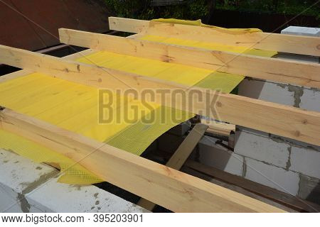Building The Roof Frame With Ceiling Joists And Rafters Over The Walls From Autoclaved Aerated Concr