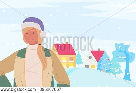 Wintertime Vacations In Winter City. Woman Wearing Warm Clothes In Front Of Town Or Village With Hou