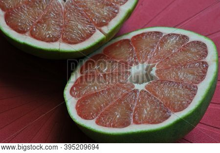 A Close Up Of The Surface Of The Red Pomelo Petals On The Red Colour  Background , Red Pomelo , Cut
