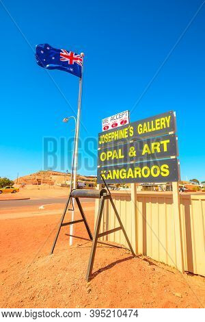Coober Pedy, South Australia, Australia - Aug 27, 2019: Australian Flag With Wellcome Signboard Of T