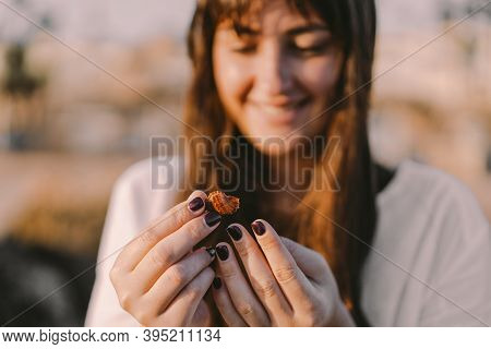 Inhabitants Of The Sea. The Girl Holds A Sea Inhabitant In A Shell On Her Hand. Vacation And Vacatio