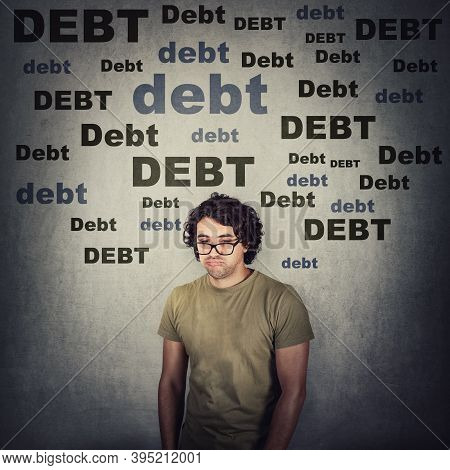 Upset And Stressed Young Man Shocked About Huge Debt Amount, Has No Money. Disappointed Guy Full Of