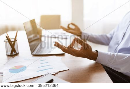 Cropped Of Unrecognizable Black Worker Meditating While Working In Office, Copy Space. African Ameri
