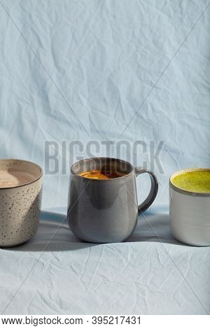 Vegan Cocoa Drink With Matcha, Turmeric And Cinnamon On Blue Background. Dairy Free Beverage
