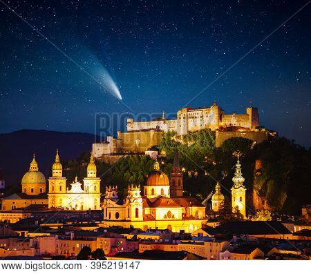 Starry sky over the Salzburg city at night. Location place Festung Hohensalzburg, Salzburger Land, Austria, Europe. Long exposure shot, astrophotography. Discover the beauty of earth.