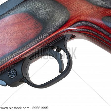 Trigger And Safety On A Rifle With A Red And Black Laminated Wood Stock