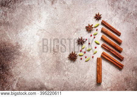 Abstract Christmas Tree Made From Spices. Christmas Tree Made Of Cinnamon Sticks, Star Anise, Cardam