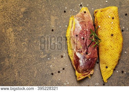 Raw Duck Breast With Sea Salt, Fresh Rosemary And Black Peppercorn
