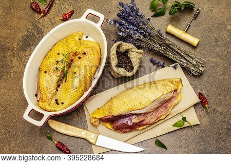 Preparation Raw Duck Breasts With Sea Salt, Fresh Rosemary, Dry Lavender And Chili