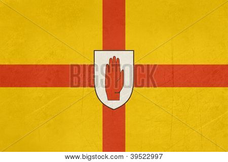 Grunge official flag of Ulster with red hand, Northern Ireland.