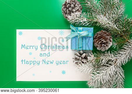 Border Of Holiday Decorations, Cones' And Gift Boxes On Green Background. Postcard With Written Wish