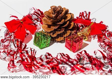 Close Up Pine Cones And Christmas Decoration On A White Wooden Table Background. Christmas And New Y