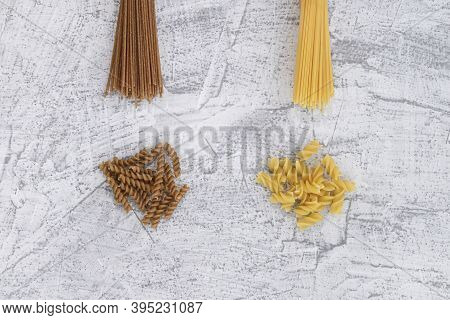 Bran Pasta. Various Pasta On A White Stone Background. View From Above
