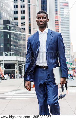 Young African American Businessman Traveling In New York City, Wearing Blue Suit, White Undershirt,