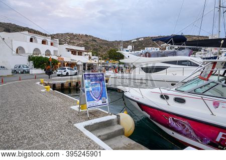 Ios, Greece - September 19, 2020: Ios, Greece - September 19, 2020: Excursion Boats Moored In The Po