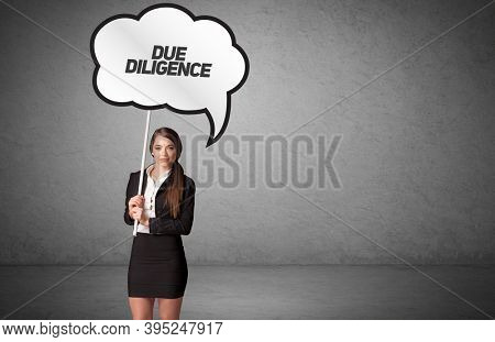 Young business person in casual holding road sign with DUE DILIGENCE inscription, new business idea concept