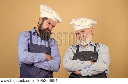 Culinary Battle. Mature Bearded Men Professional Restaurant Cooks Competitors. Culinary Show. Chef M