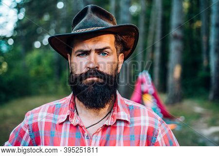 Mature Man In Shirt With Beard In Hat. Bearded Man Relax In Forest. Serious Bearded Man. Attractive