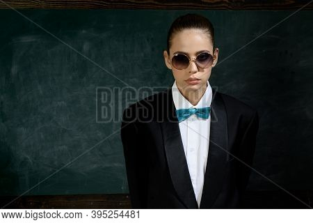 Woman Wear Masculine Clothes Tuxedo Bow Tie And Eyeglasses. Sunglasses Formal Style. Girl Formal Jac