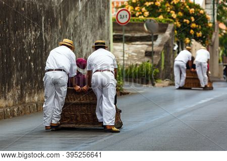 FUNCHAL, MADEIRA - SEPTEMBER 19: Traditional downhill sledge trip on September 19, 2016 in Madeira, Portugal.